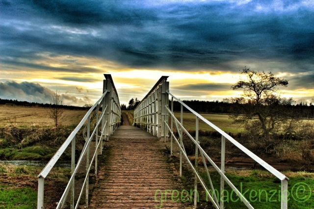 Footbridge into sunset